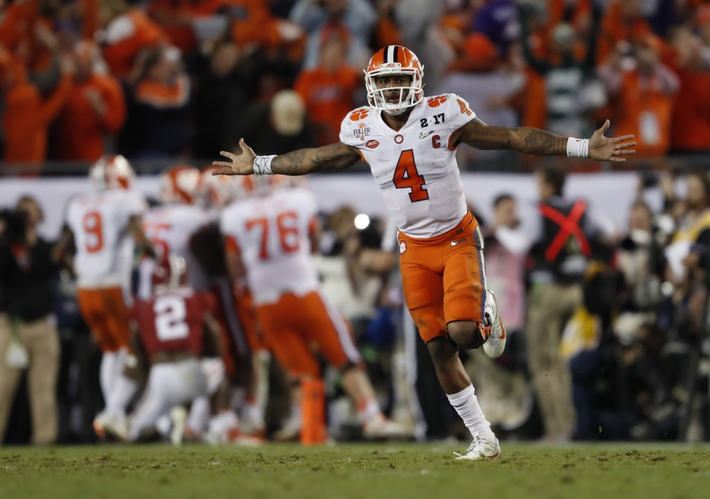 FILE - In this Jan. 10, 2017, file photo, Clemson's Deshaun Watson celebrates a last second game-winning touchdown pass to Hunter Renfrow in the secon...