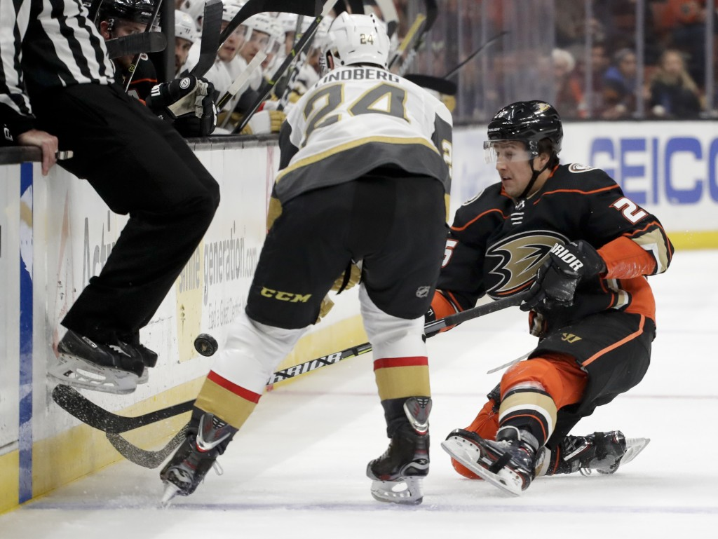 Anaheim Ducks right wing Ondrej Kase, right, knocks the puck away from Vegas Golden Knights center Oscar Lindberg during the second period of an NHL h...