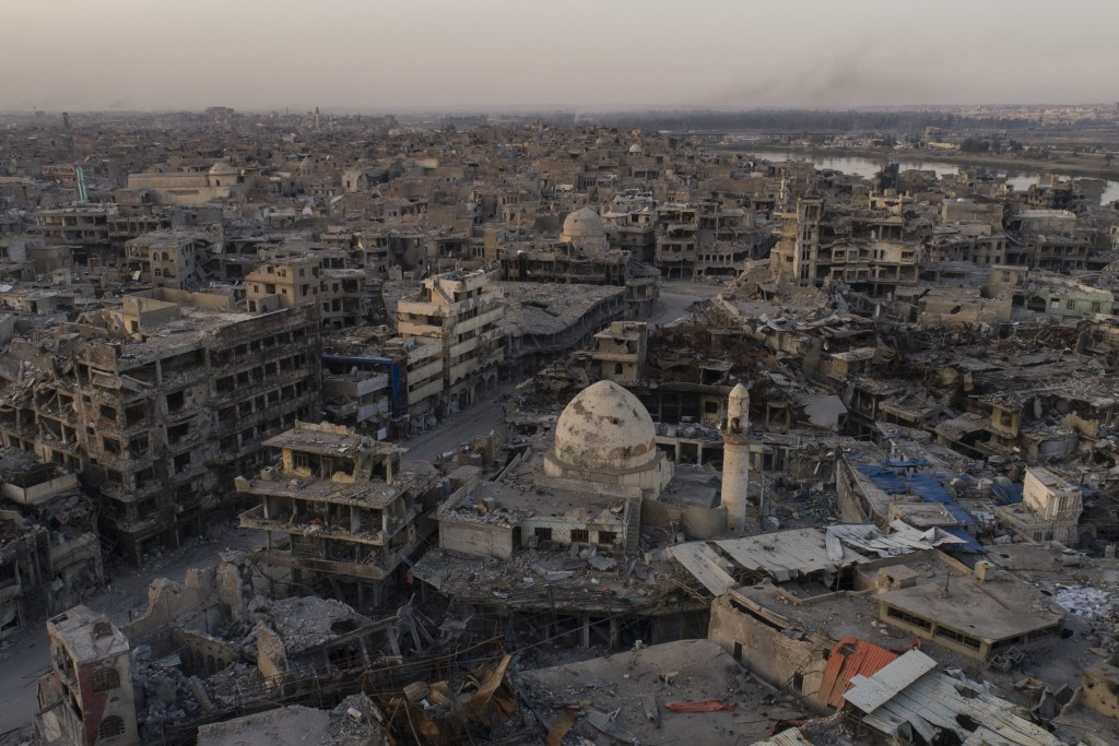 In this Nov. 15, 2017 photo, aerial view of destroyed building and shops in the Old City of Mosul, Iraq. The scope of destruction in the neighborhood ...