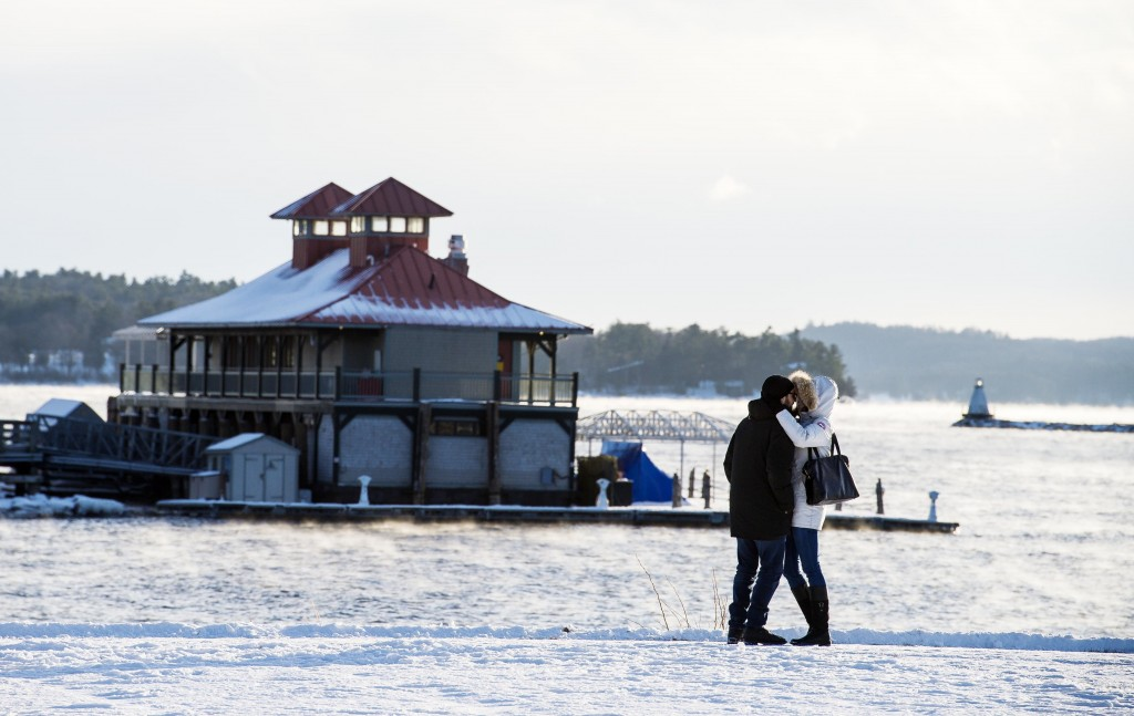 A couple embraces as they brave the cold weather for a walk in Waterfront Park in Burlington, Vt., Wednesday, Dec. 27, 2017. Freezing temperatures and...
