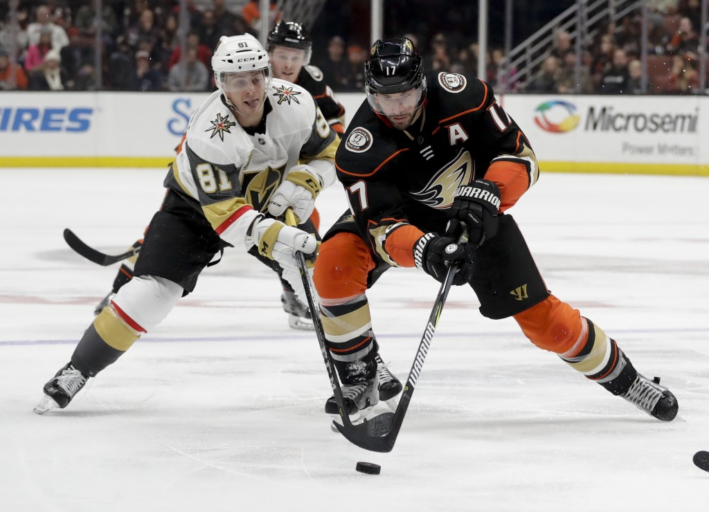 Anaheim Ducks' Ryan Kesler, right, shoots past Vegas Golden Knights center Jonathan Marchessault during the second period of an NHL hockey game in Ana...