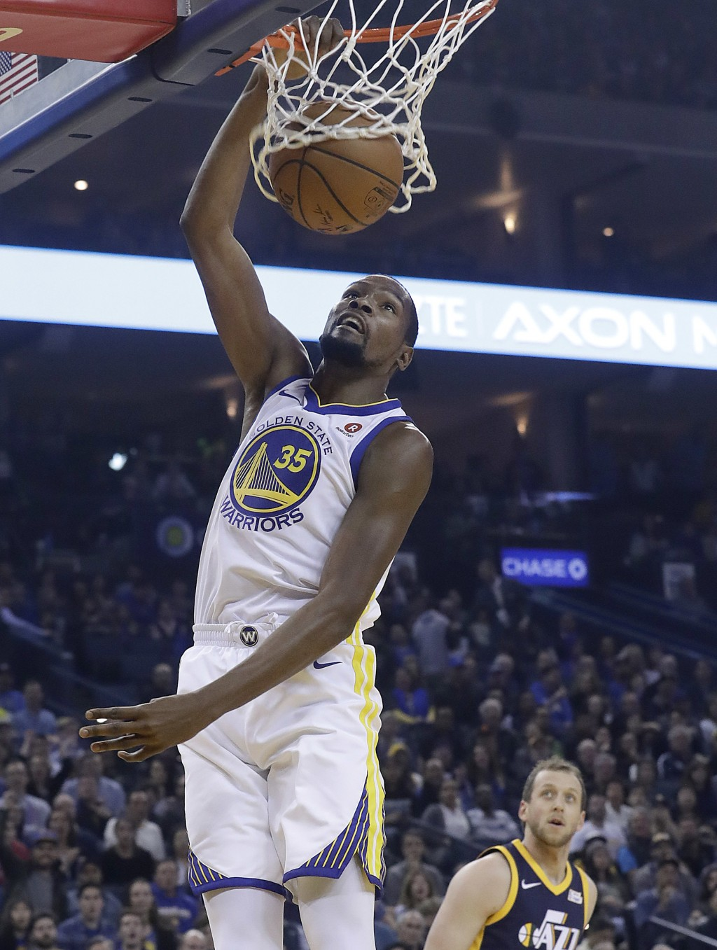 Golden State Warriors forward Kevin Durant (35) dunks against the Utah Jazz during the first half of an NBA basketball game in Oakland, Calif., Wednes...