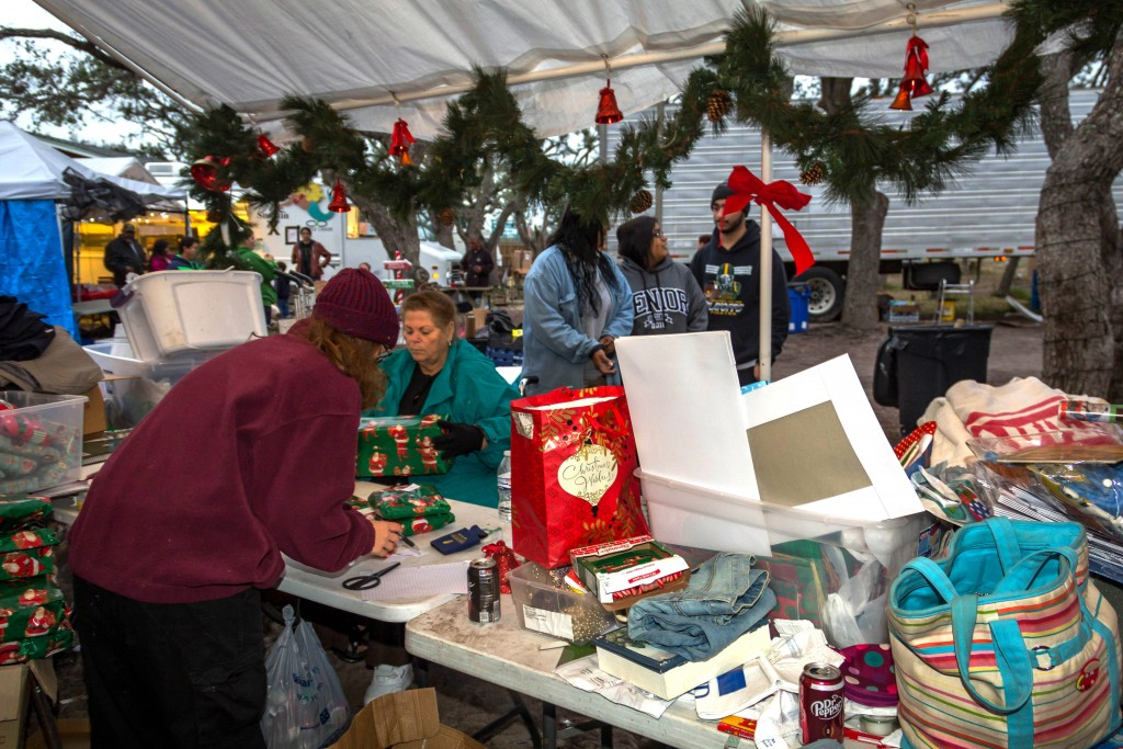 In this Dec. 15, 2017 photo provided by Kim Porter, volunteers are shown getting gift packages together to distribute at the Rockport Relief Camp in R...