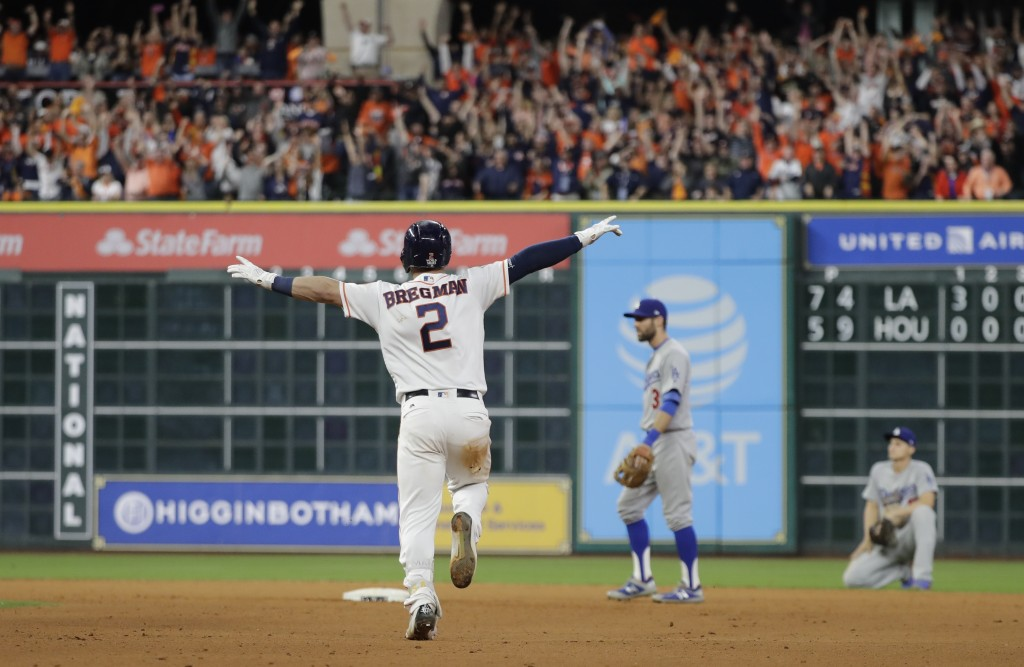 FILE - In this Oct. 30, 2017, file photo, Houston Astros' Alex Bregman reacts after driving in the game-winning run in the 10th inning of Game 5 of ba...