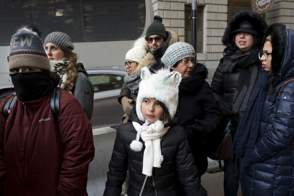 People are all bundled up as they walk in lower Manhattan, Dec. 27, 2017, in New York. A white Christmas for much of the Northeast and Midwest has giv...