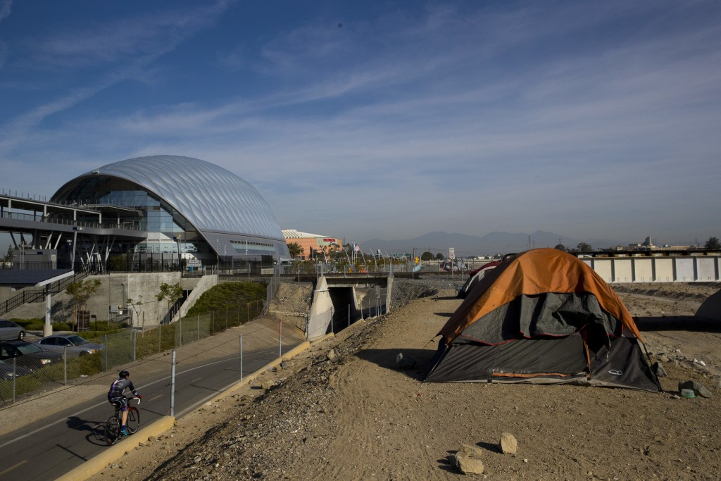 Homeless tents are pitched on the Santa Ana River trail near the Anaheim Regional Transportation Intermodal Center, a $185-million transportation cent...