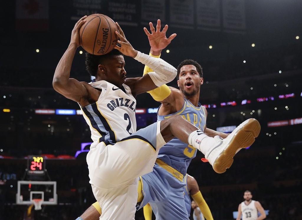 Memphis Grizzlies' Kobi Simmons, left, gets a rebound against Los Angeles Lakers' Josh Hart during the first half of an NBA basketball game Wednesday,...