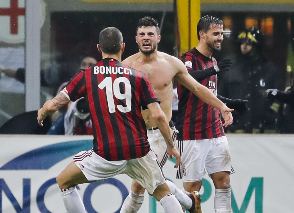 AC Milan's Patrick Cutrone, center, celebrates with his teammates after scoring for his team during an Italian Cup quarter-final soccer match between ...