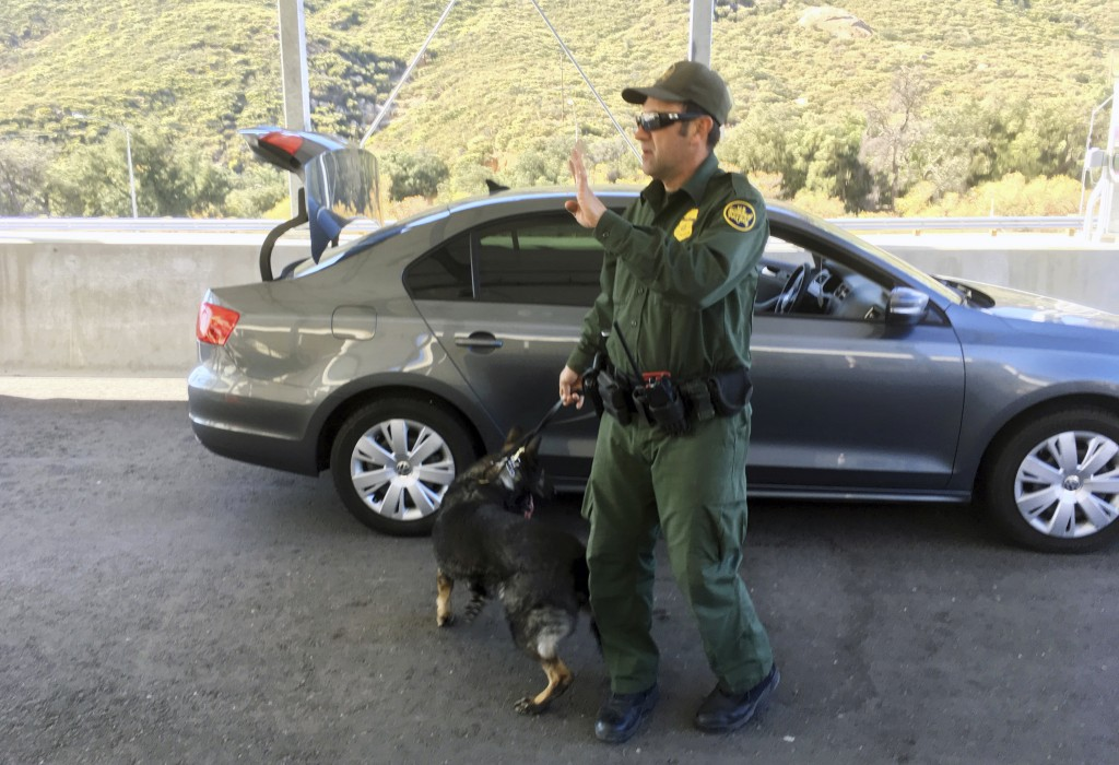 In this Thursday, Dec. 14, 2017 photo, a border patrol agent stops a vehicle at a checkpoint in Pine Valley, Calif. California legalizes marijuana for...