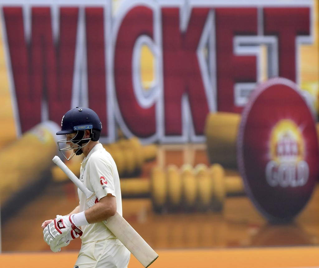 England's Joe Root walks off after he was caught out by Australia's Nathan Lyon for 61 runs during the third day of their Ashes cricket test match in ...
