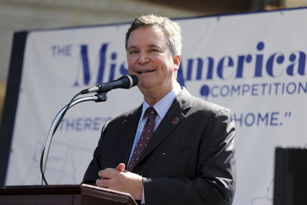 FILE- In this Aug. 30, 2016, file photo, Sam Haskell, left, CEO of Miss America Organization, speaks during Miss America Pageant arrival ceremonies in...