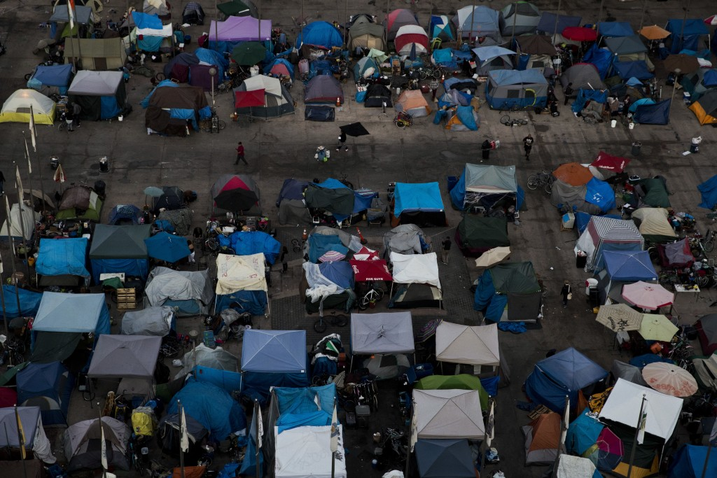 A large homeless encampment is formed in the Santa Ana Civic Center on Wednesday, Oct. 11, 2017, in Santa Ana, Calif. The number of homeless living in...