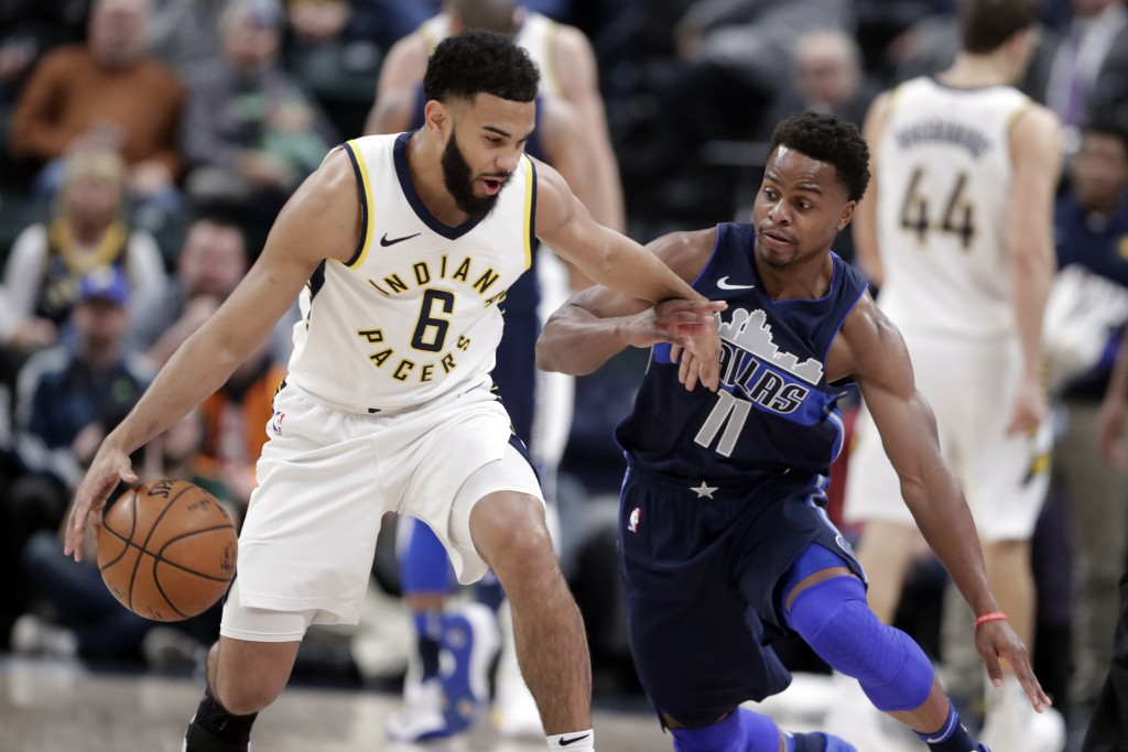 Dallas Mavericks guard Yogi Ferrell (11) defends Indiana Pacers guard Cory Joseph (6) during the first half of an NBA basketball game in Indianapolis,...
