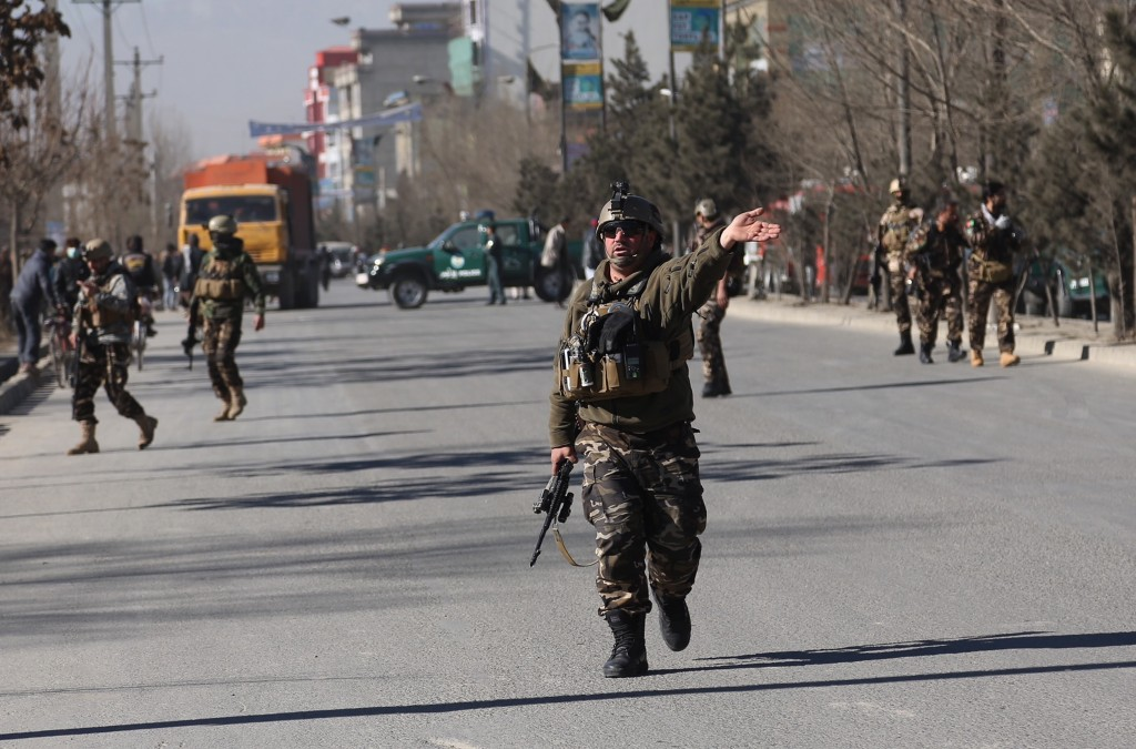 Security personnel arrive outside the site of a suicide attack in kabul, Afghanistan, Thursday, Dec. 28, 2017.  Authorities say an attack took place o...