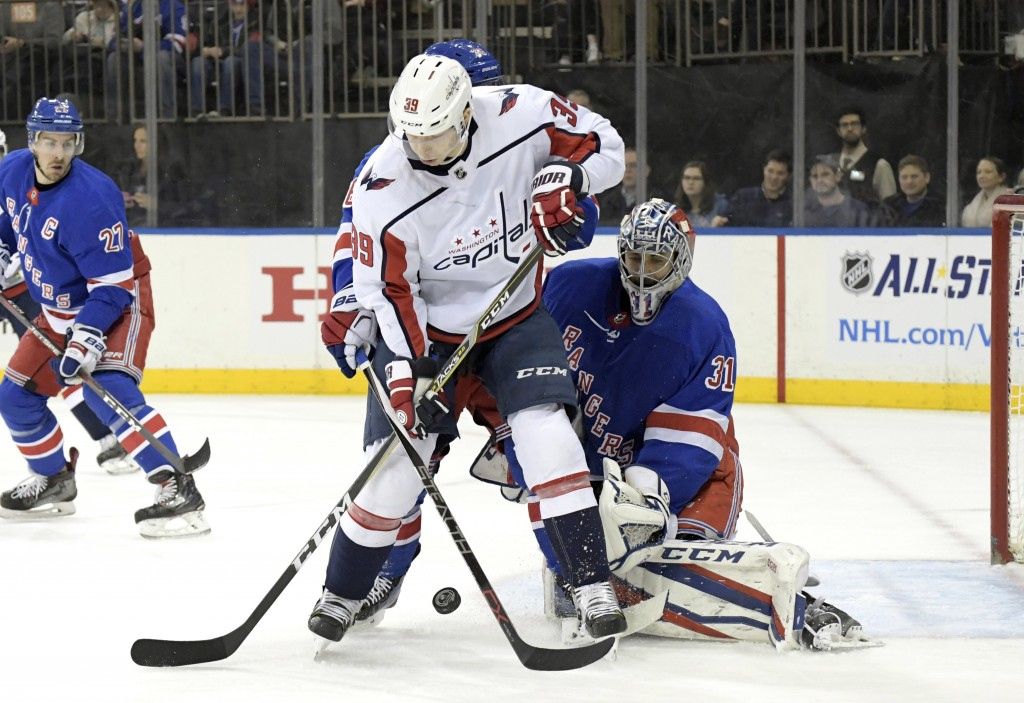Washington Capitals right wing Alex Chiasson (39) battles for control of the puck with New York Rangers right wing Mats Zuccarello, rear, as New York ...