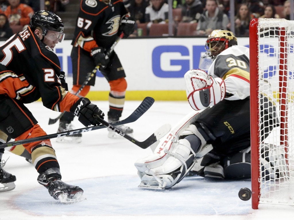 Vegas Golden Knights goalie Malcolm Subban, right, blocks a shot by Anaheim Ducks right wing Ondrej Kase during the second period of an NHL hockey gam...