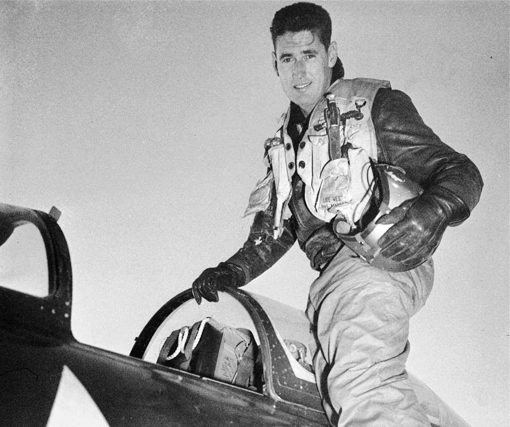 FILE - In this 1953 file photo, Capt. Ted Williams, former Boston Red Sox slugger, poses atop an airplane at a Marine air base in Korea after he crash...