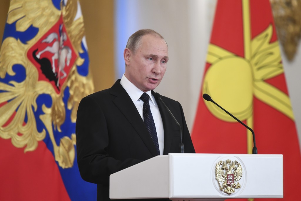 Russian President Vladimir Putin delivers a speech during an award ceremony in the Kremlin, in Moscow, Russia, Thursday, Dec. 28, 2017, for Russian Ar...