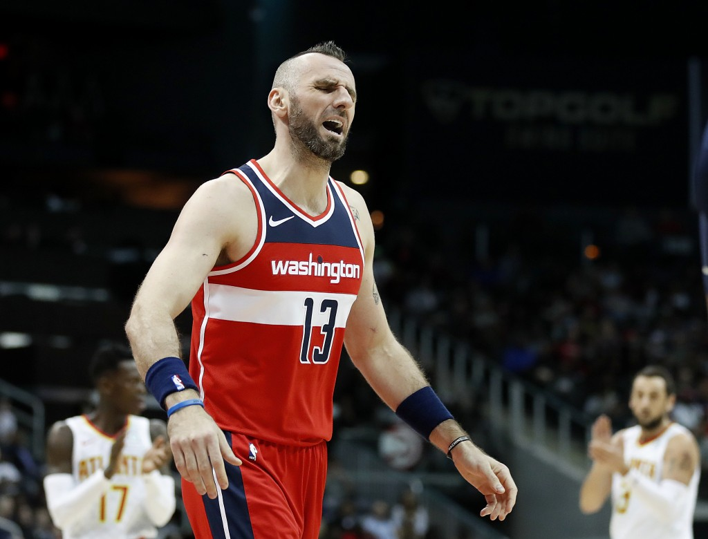 Washington Wizards' Marcin Gortat, of Poland, reacts after being called for a foul in the second quarter of an NBA basketball game against the Atlanta...