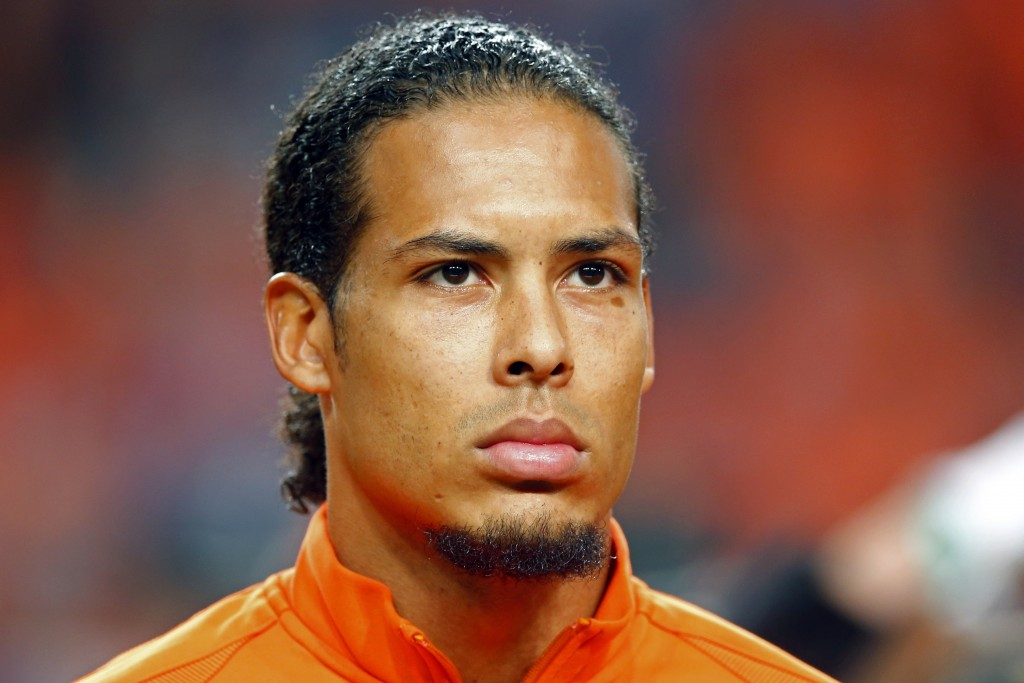 FILE - In this Monday, Oct. 10, 2016 file photo, Netherlands' Virgil van Dijk listens to the national anthem prior to their World Cup Group A qualifyi...