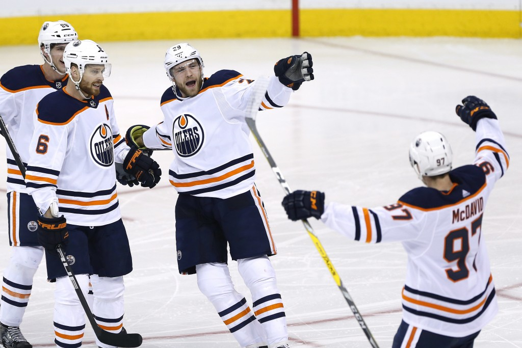 Edmonton Oilers' Brandon Davidson (88), Adam Larsson (6), Leon Draisaitl (29) and Connor McDavid (97) celebrate Draisaitl's goal against the Winnipeg ...