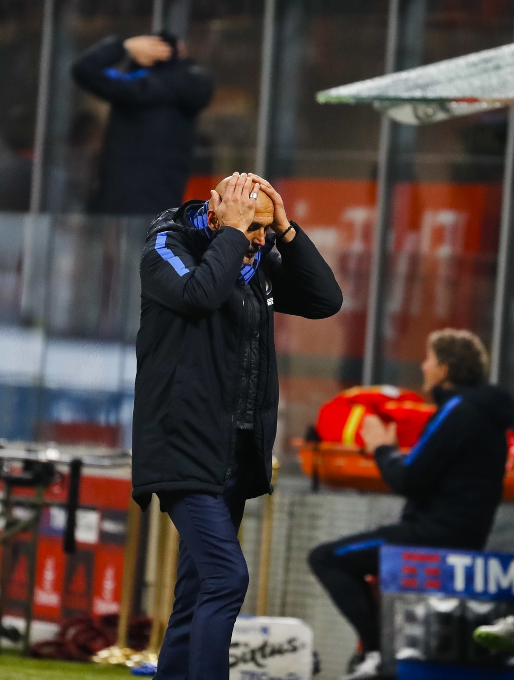 Inter Milan coach Luciano Spalletti touches his head during an Italian Cup quarter-final soccer match between Milan and Inter Milan at the San Siro st...