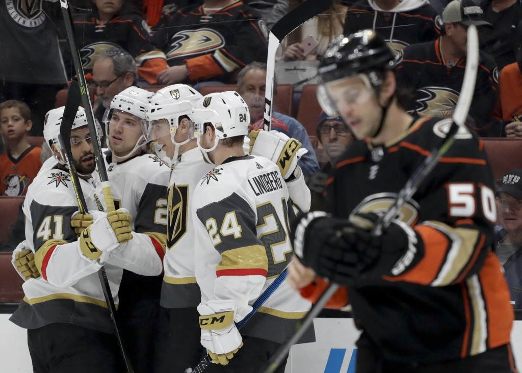 Members of the Vegas Golden Knights celebrates after a goal by defenseman Shea Theodore as Anaheim Ducks center Antoine Vermette skates by during the ...