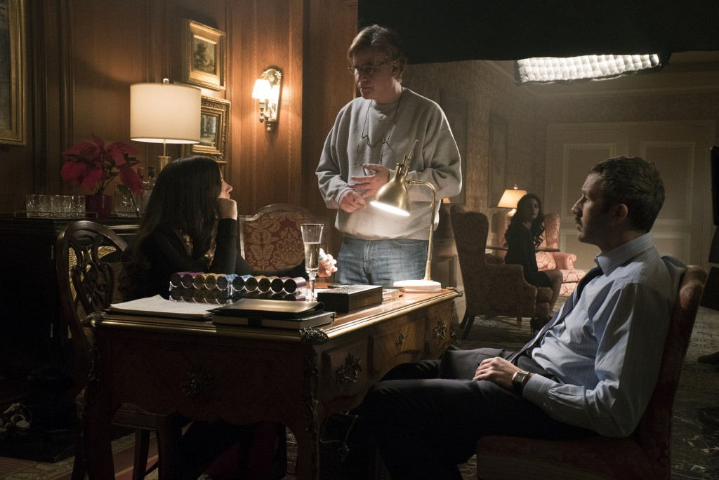 """This image released by STXfilms shows Jessica Chastain, from left, director Aaron Sorkin, and Chris O'Dowd on the set of """"Molly's Game."""" In """"Molly's G..."""