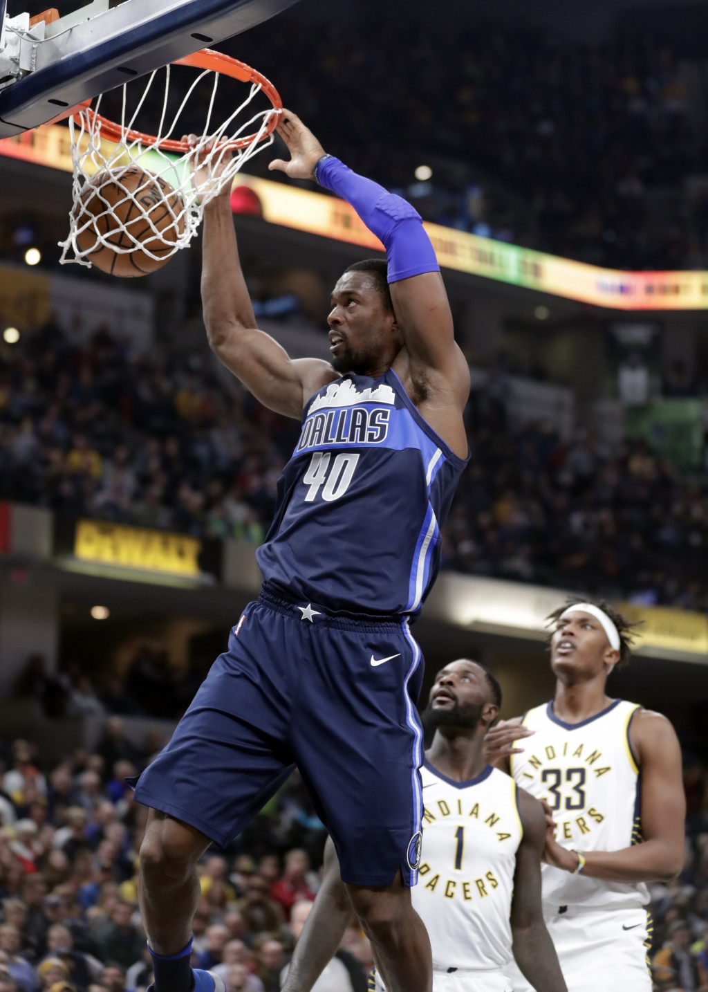 Dallas Mavericks forward Harrison Barnes dunks in front of Indiana Pacers center Myles Turner (33) and guard Lance Stephenson (1) during the first hal...