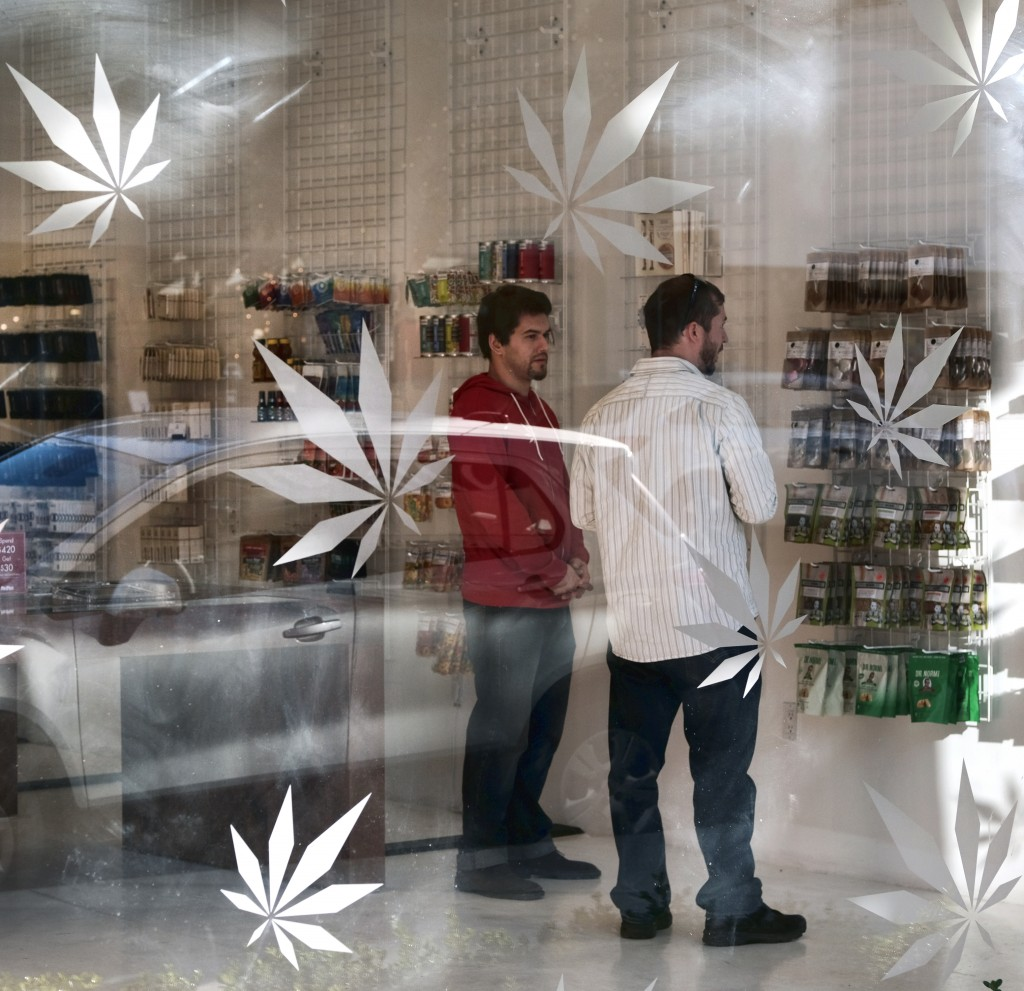 FILE - In this Dec. 21, 2017, file photo, a customer browses a selection of marijuana products at MedMen a medical marijuana dispensary in Los Angeles...