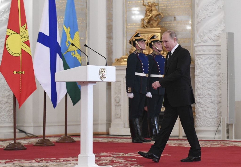 Russian President Vladimir Putin walks to deliver a speech during an award ceremony in the Kremlin, in Moscow, Russia, Thursday, Dec. 28, 2017, for Ru...