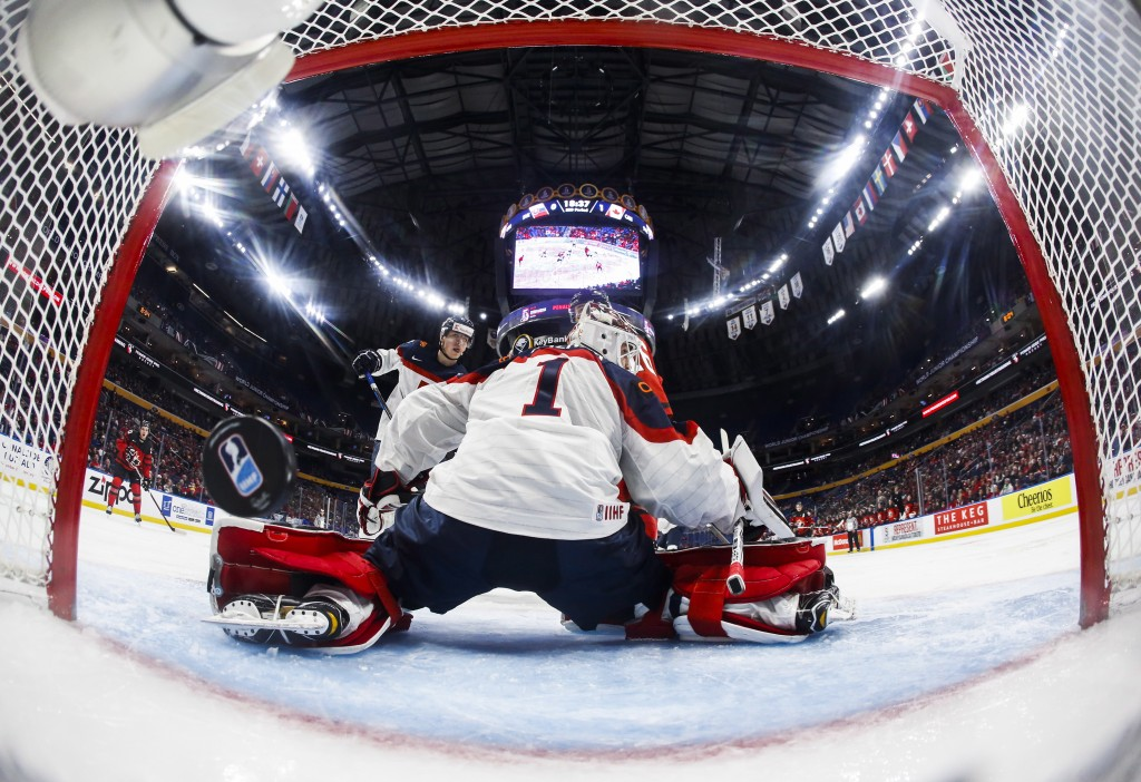 Slovakia goalie David Hrenak lets in a goal by Canada's Jordan Kyrou (obscured) during the third period of IIHF World Junior Championship preliminary ...
