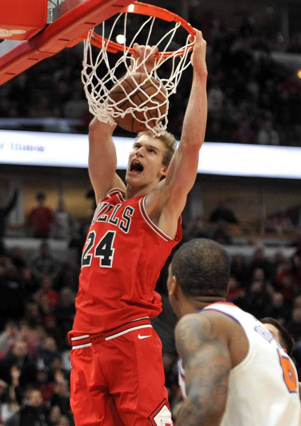 Chicago Bulls' Lauri Markkanen (24), of Finland, dunks during the final minutes of the second half of an NBA basketball game against the New York Knic...