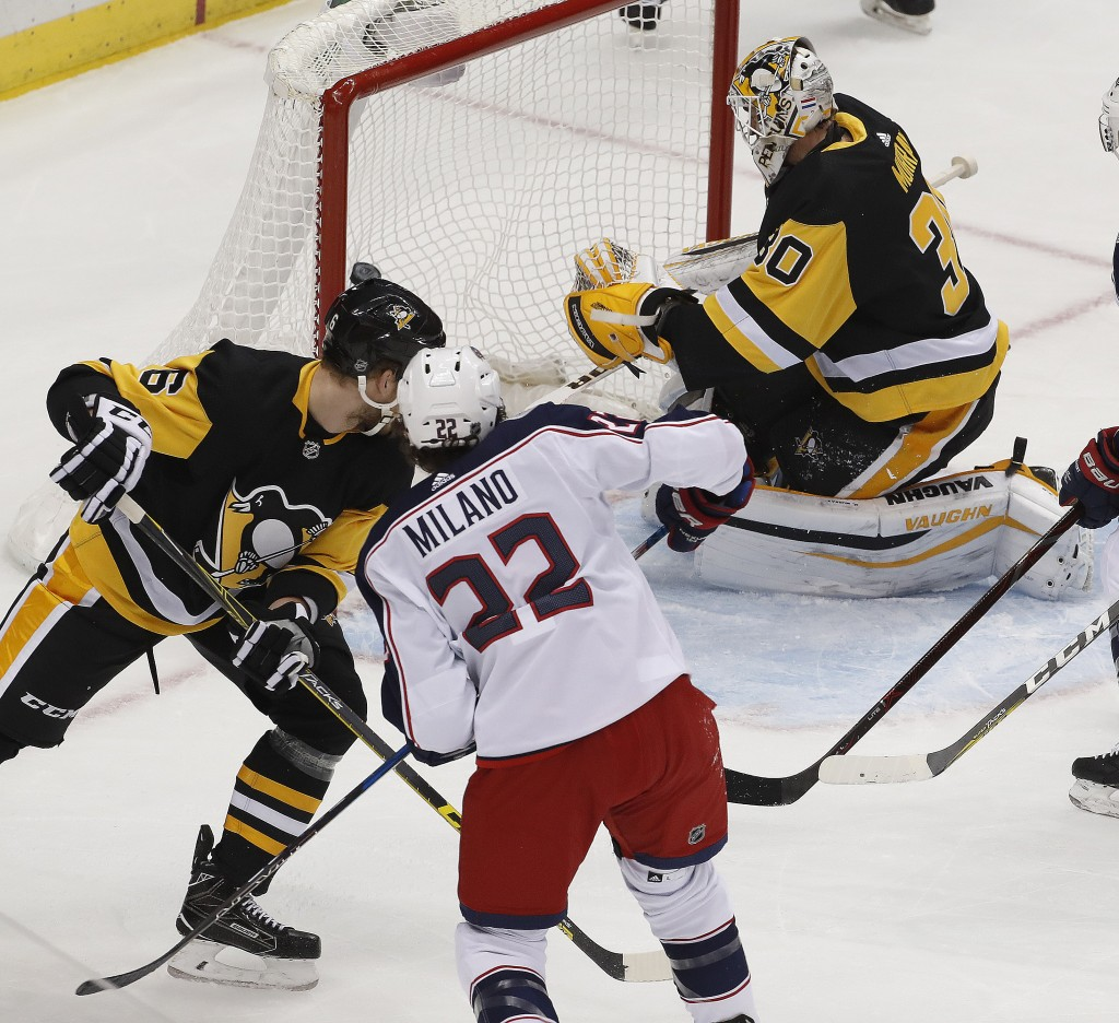 Columbus Blue Jackets' Sonny Milano (22) gets a shot past Pittsburgh Penguins goalie Matt Murray (30) for a goal during the first period of an NHL hoc...
