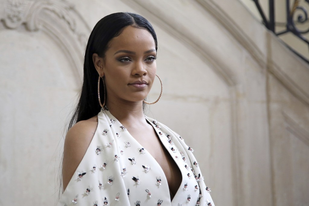 FILE - In this Sept. 30, 2016, file photo, Singer Rihanna poses for photographers as she arrives to Christian Dior's Spring-Summer 2017 ready-to-wear ...