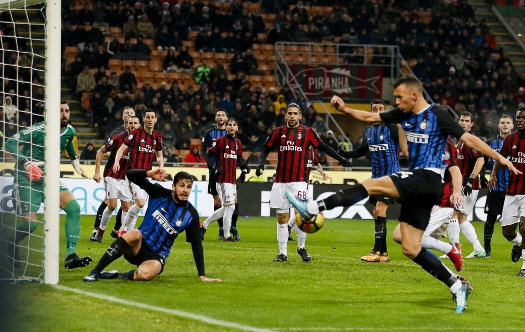 Inter Milan's Ivan Perisic, right, kicks the ball to score a goal that was later disallowed because of his teammate Andrea Ranocchia's off-side (secon...