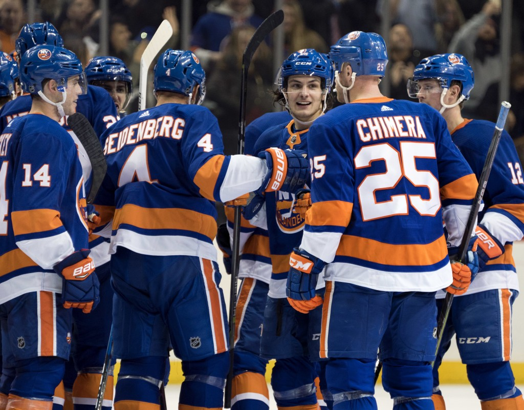 New York Islanders' Mathew Barzal, center right, celebrates with teammates after scoring the game winning goal in overtime against the Buffalo Sabres'...