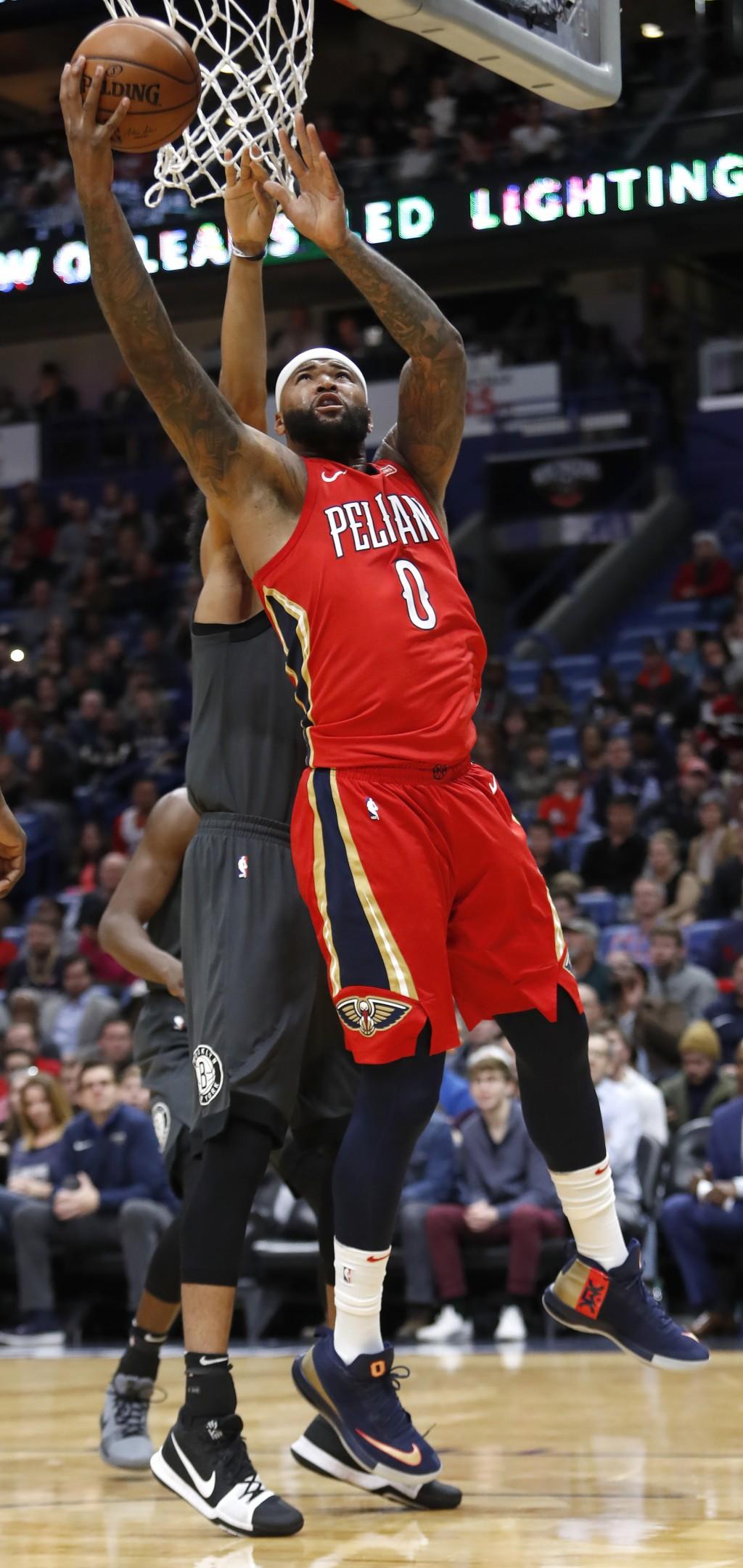 New Orleans Pelicans center DeMarcus Cousins (0) shoots over Brooklyn Nets center Jarrett Allen (31) in the first half of an NBA basketball game in Ne...