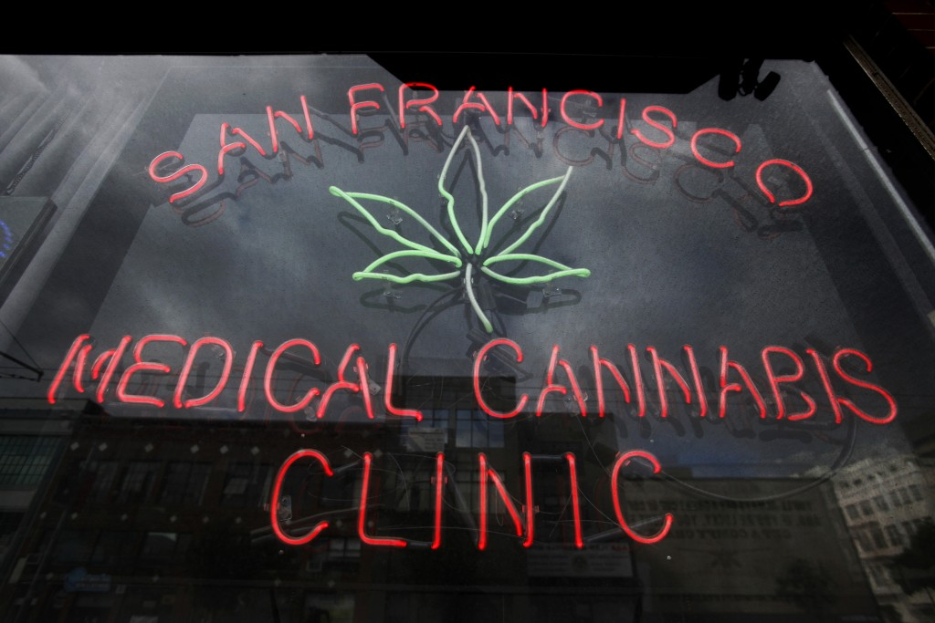 FILE - This Oct. 19, 2009, file photo shows a neon sign at the entrance to the San Francisco Medical Cannabis Clinic in San Francisco. In the two deca...