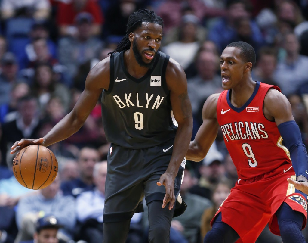 Brooklyn Nets forward DeMarre Carroll (9) drives past New Orleans Pelicans guard Rajon Rondo (9) in the first half of an NBA basketball game in New Or...