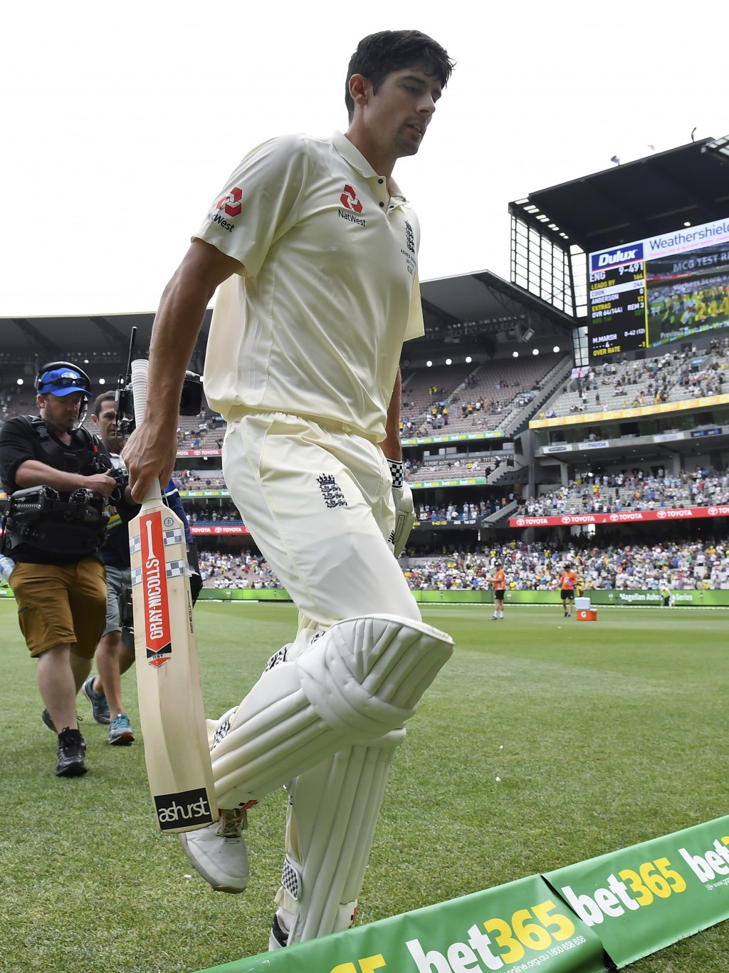 England's Alastair Cook walks off the ground not out at stumps on the third day of their Ashes cricket test match against Australia in Melbourne, Aust...