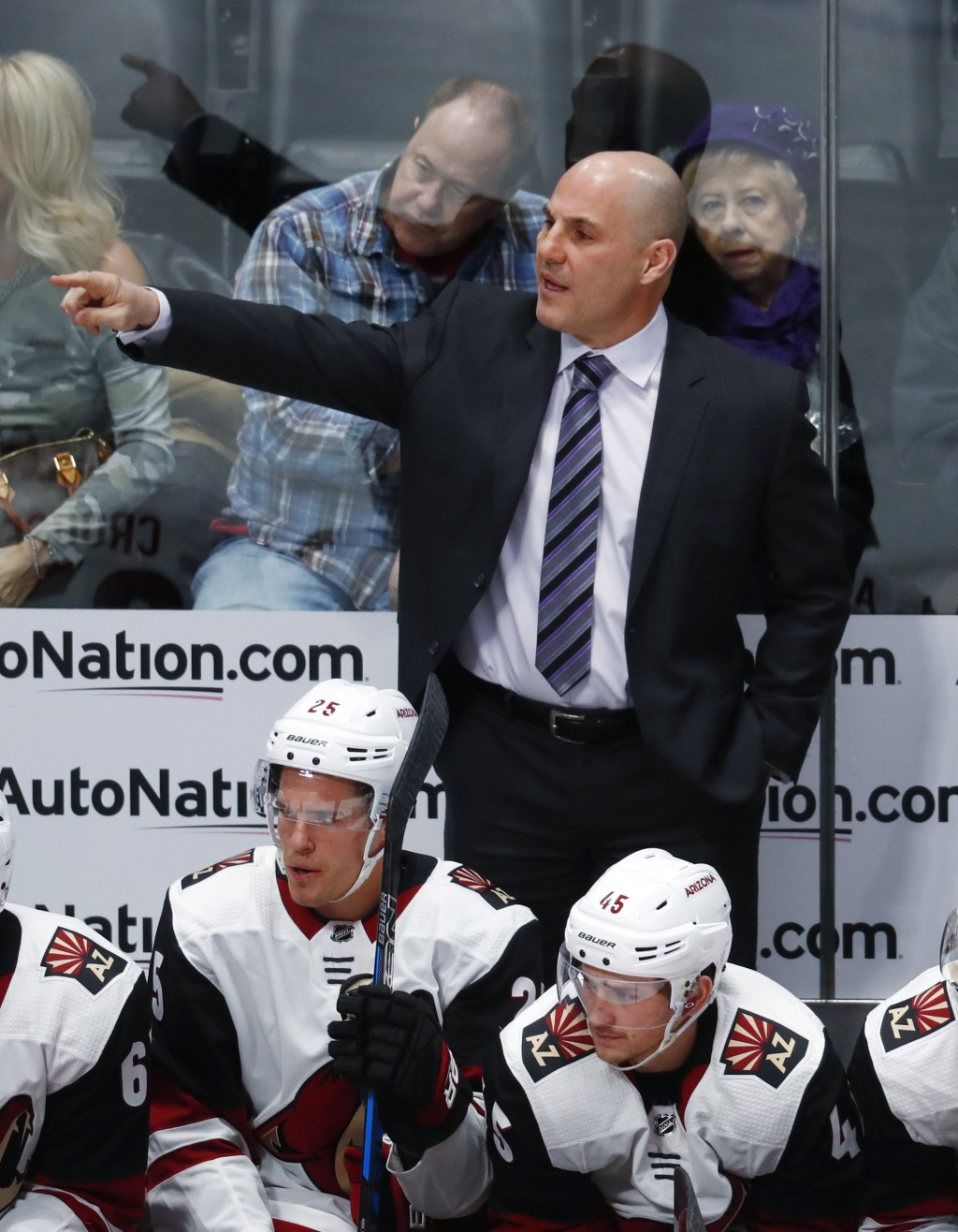 Arizona Coyotes head coach Rick Tocchet directs his team against the Colorado Avalanche in the first period of an NHL hockey game Wednesday, Dec. 27, ...