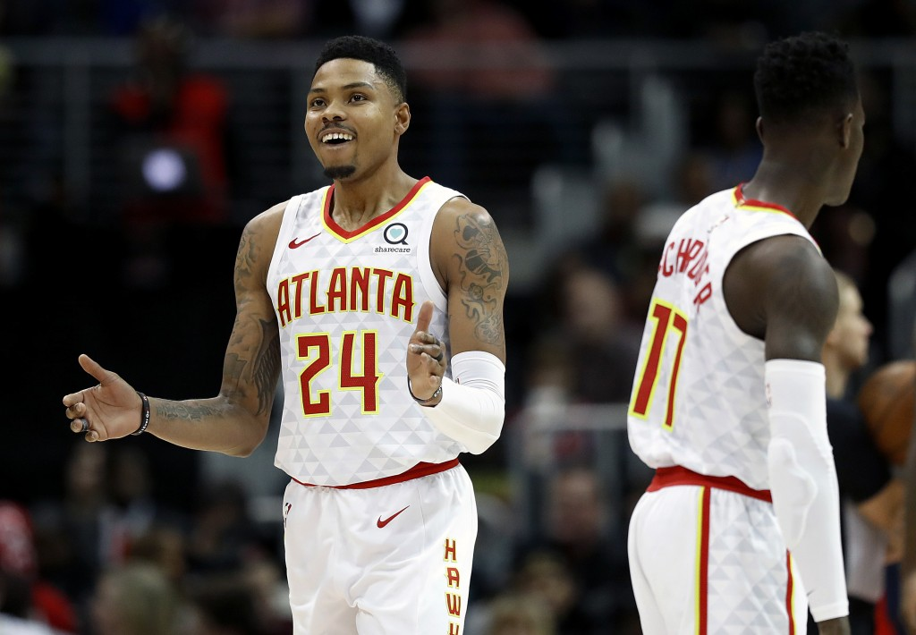 Atlanta Hawks' Kent Bazemore, left, reacts after stealing an inbound pass in the fourth quarter of an NBA basketball game against the Washington Wizar...