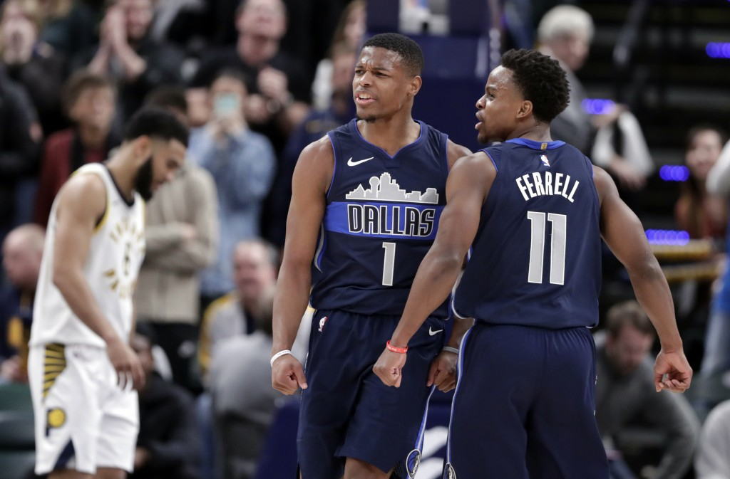 Dallas Mavericks guards Dennis Smith Jr. (1) and Yogi Ferrell (11) celebrate during the closing minute of the team's NBA basketball game against the I...