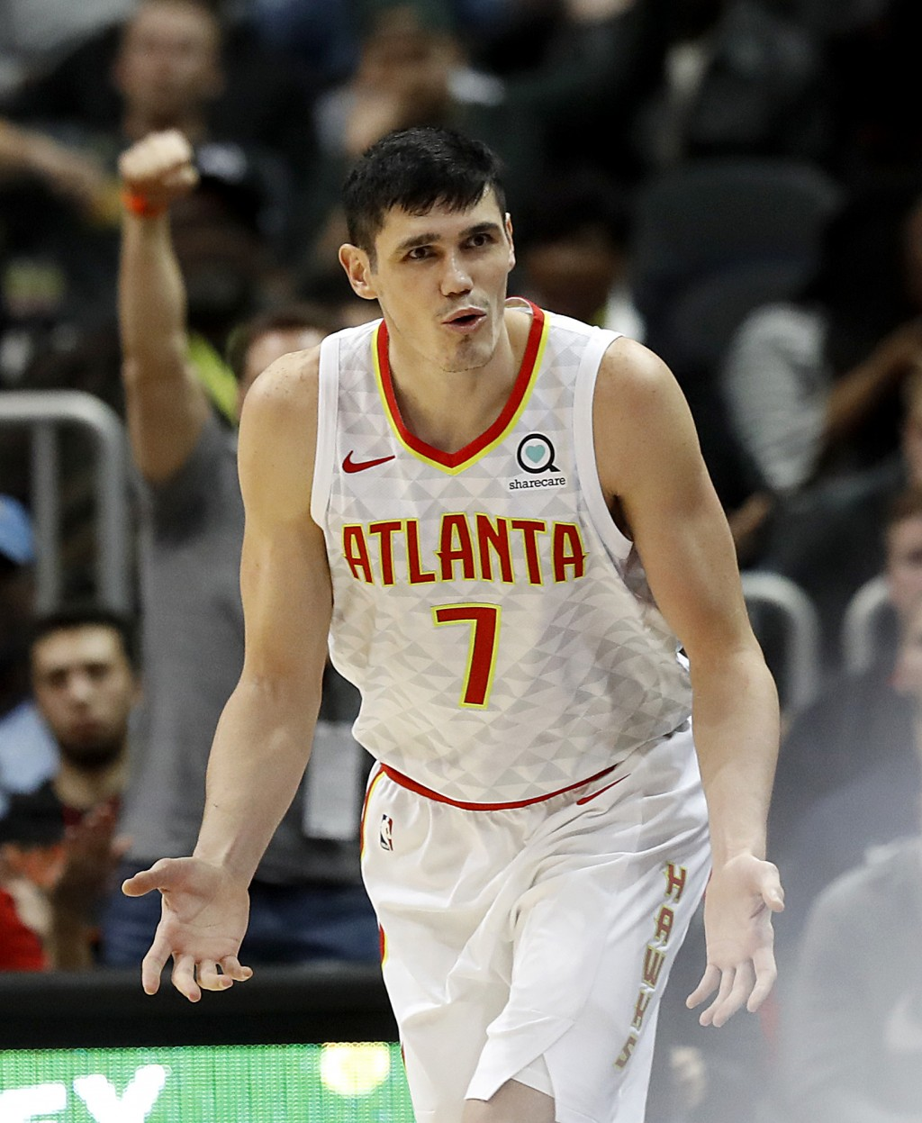 Atlanta Hawks' Ersan Ilyasova, of Turkey, reacts after hitting a three-point basket in the fourth quarter of an NBA basketball game against the Washin...