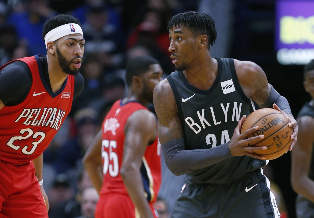 Brooklyn Nets forward Rondae Hollis-Jefferson (24) is defended by New Orleans Pelicans forward Anthony Davis (23) in the first half of an NBA basketba...