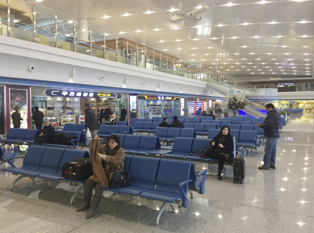 In this Dec. 23, 2017, photo, passengers wait for their flights in the departures lobby of Pyongyang's international airport. Despite being one of the...
