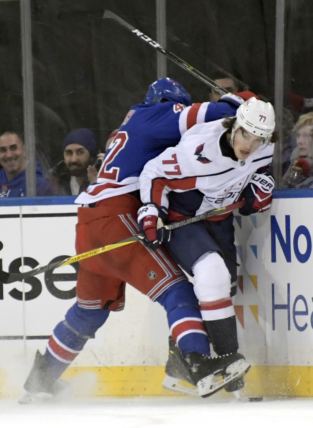 New York Rangers defenseman Brendan Smith (42) checks Washington Capitals right wing T.J. Oshie (77) during the second period of an NHL hockey game, W...