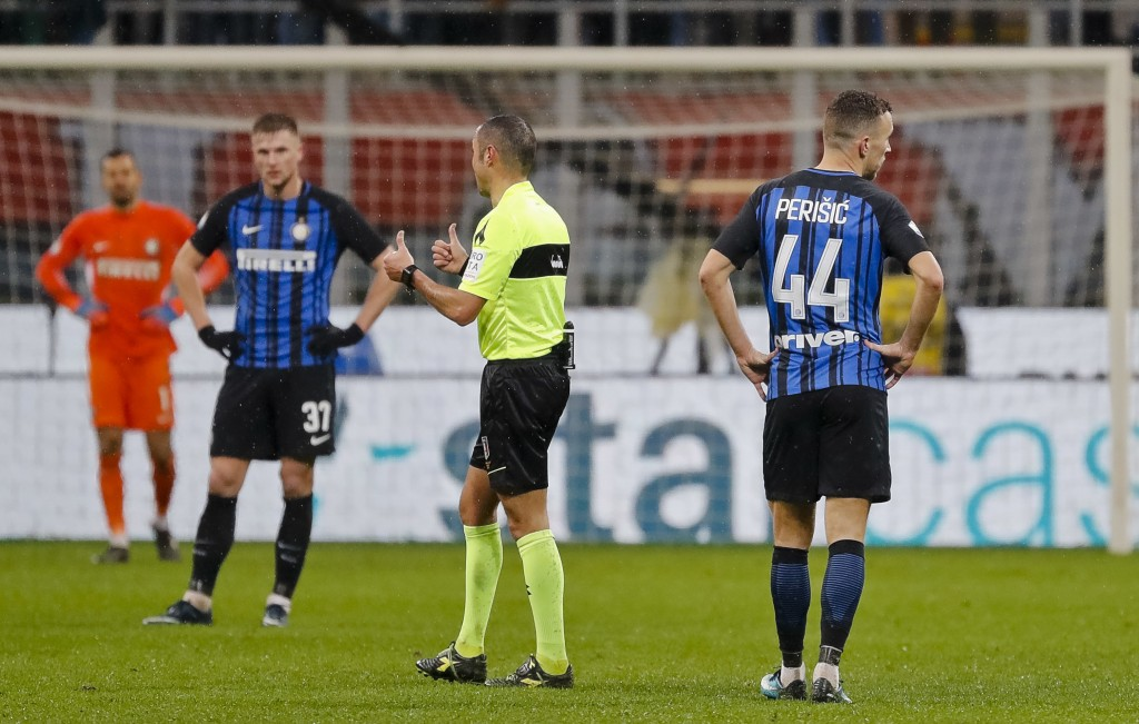 Referee Marco Guida, third from left, gesticulates as Inter Milan's players, from left, Samir Handanovic, Milan Skriniar, and Ivan Perisic look on aft...