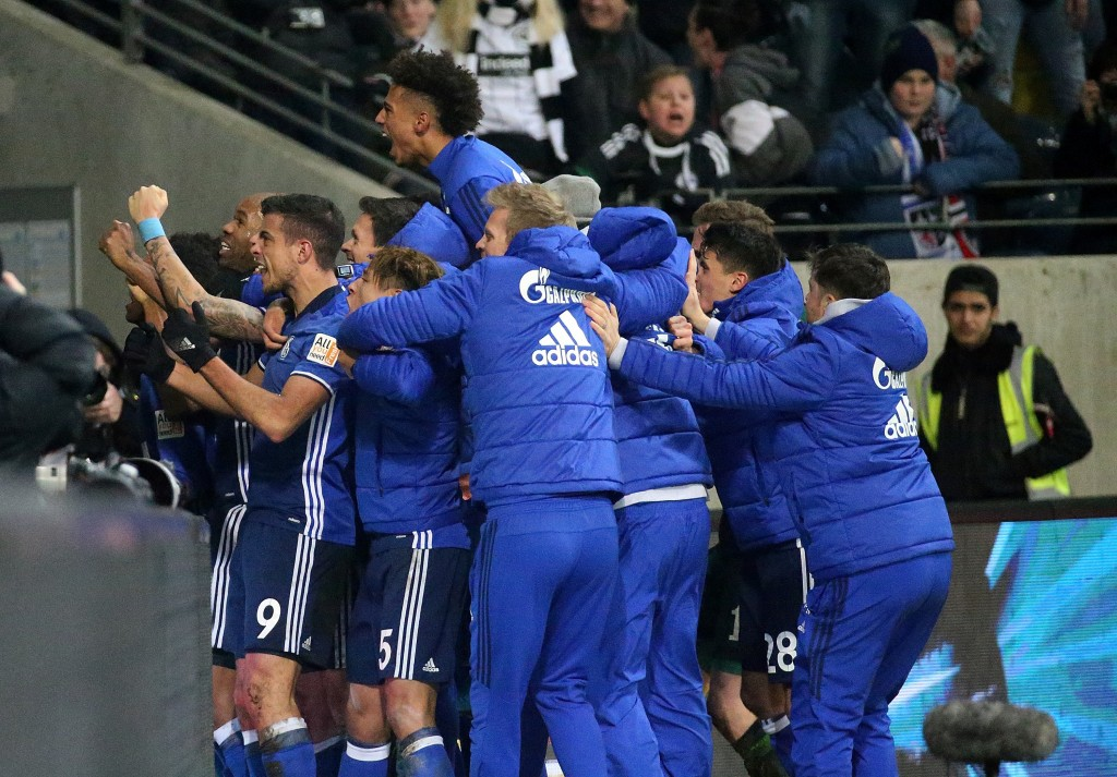 FILE - In this Dec, 16, 2017 file photo Schalke players celebrate after scoring the equalizing 2-2, during the German Bundesliga soccer match between ...